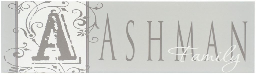 Gray family established name sign with monogram with a flourish. Family name is in charcoal