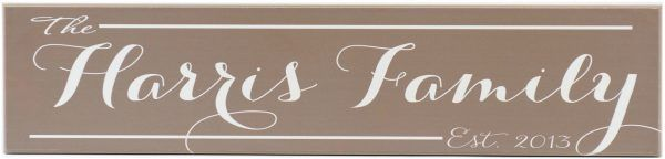 Family Established Sign in light brown, personalized family name in white script through the middle, and Established year in the bottom right corner of the wood sign
