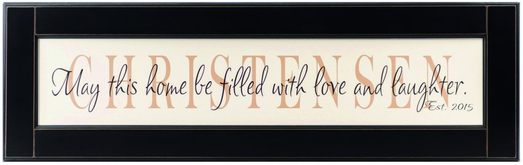 "Personalized Wood Framed Sign. Off white wood sign with tan family name framed in black wood frame with saying ""May this home be filled with love and laugher"", and established date in black"