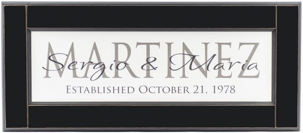Personalized wood framed Sign White wood sign with charcoal family name framed in black wood frame with couple's names and established date in black complete view