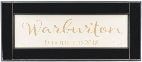 Personalized wood framed Sign. Off white wood sign with tan family name and established year framed straight view