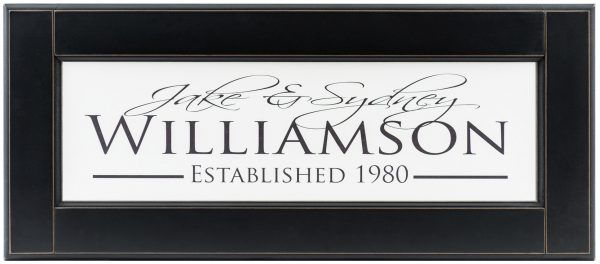 Personalized wood framed Sign White wood sign with black family name, couples names and established date framed in black wood frame complete view