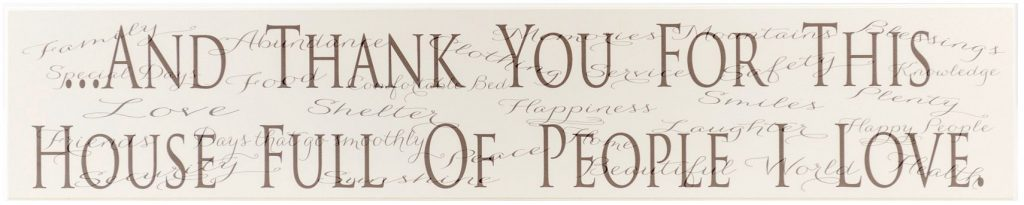 """Off White wooden kitchen sign with the text """"And thank you for this house full of people I love"""" in black text through the middle of the sign and a list of things to be grateful for in the background."""