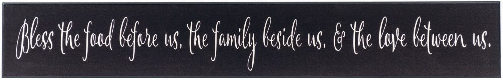 "Black wooden kitchen sign with the text ""Bless the food before us, the family beside us, and the love between us"" in off white text through the middle of the sign."