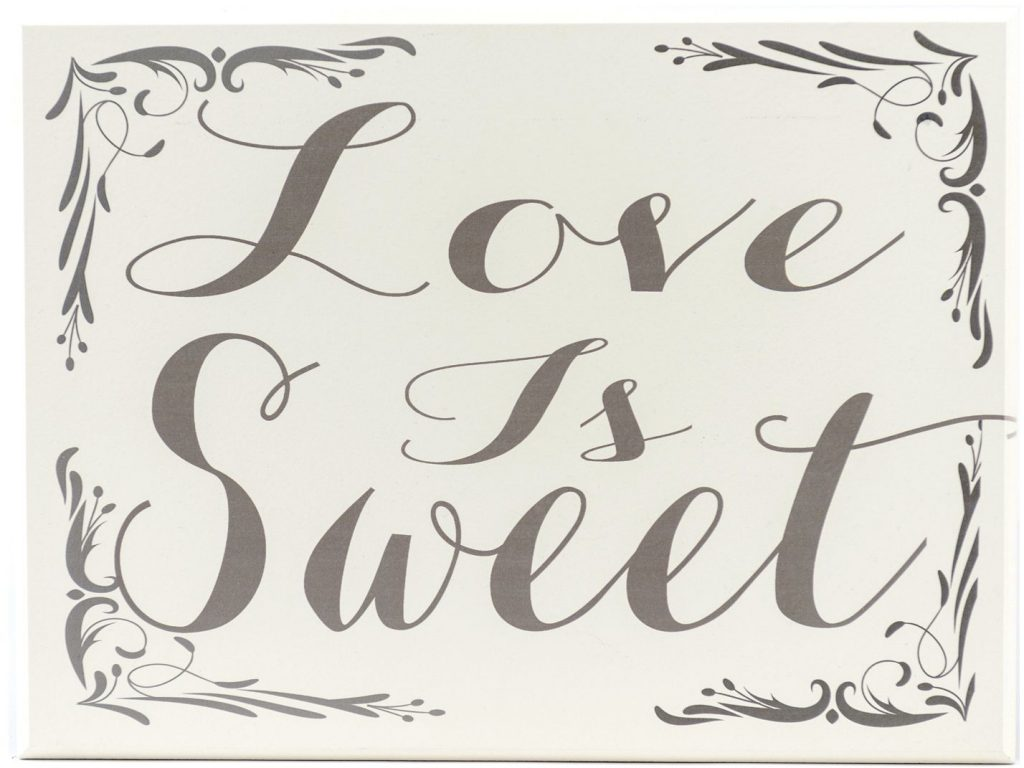 "Valentines Day Holiday Wood Sign with, ""Love Is Sweet"" text on off white background."