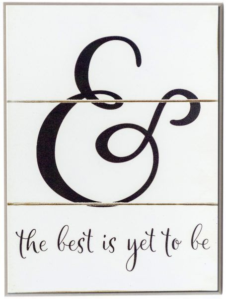 "Rustic off white wood plaque with the text, ""& The Best is Yet To Be"" in black through the middle of the sign."