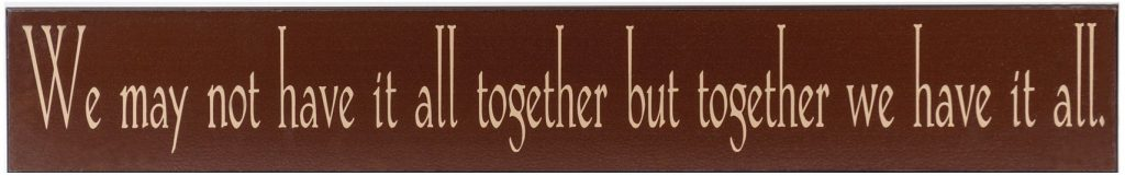 "Chocolate wooden family sign with the words ""We may not have it all together but together we have it all"" in tan across the front of the sign."