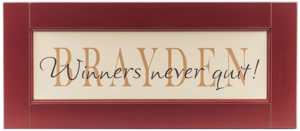 Personalized name sign framed in a red wood frame for boys bedroom wall decor.