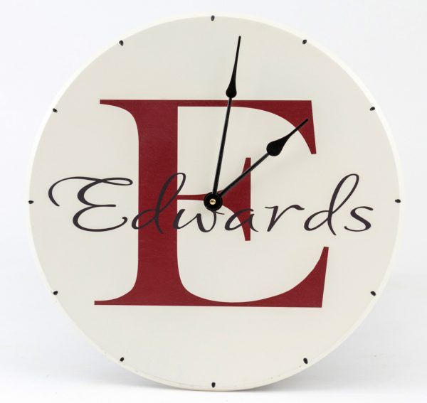 Personalized round clock with family name and monogram and establsihed date.