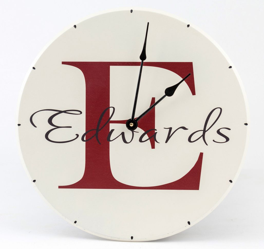 Personalized wooden wall clock with family name and monogram with red letter name and white background