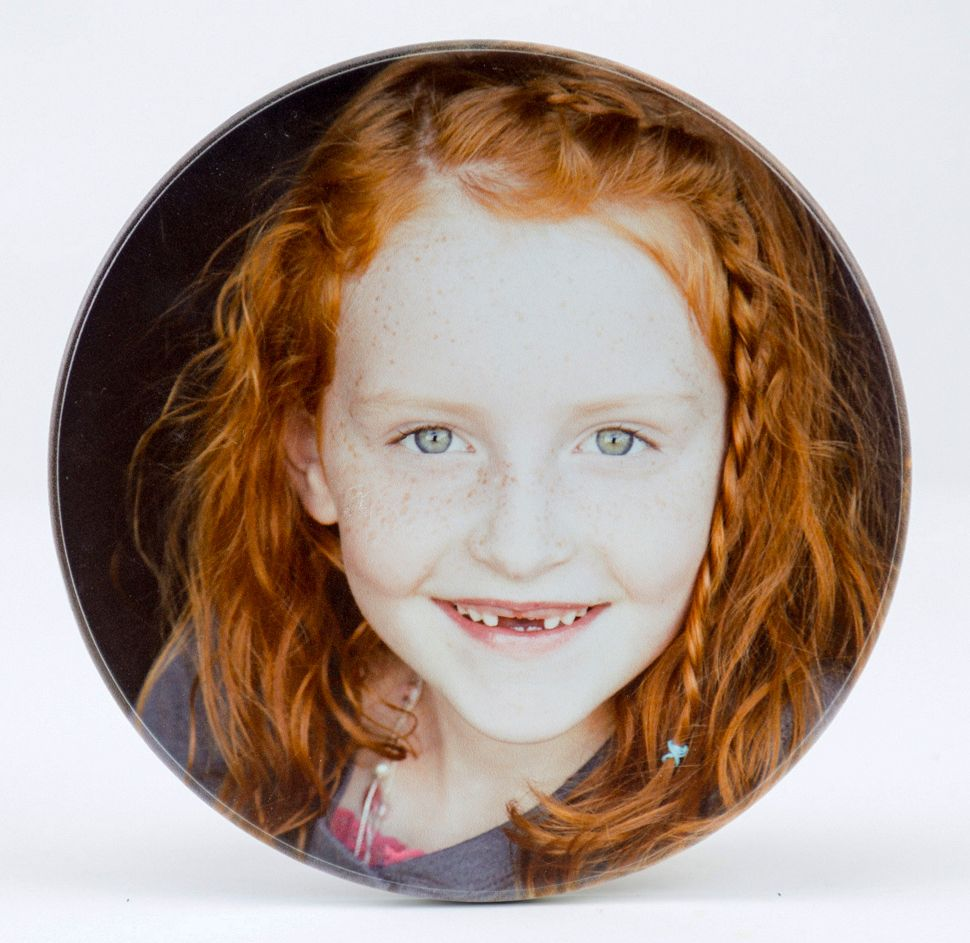 round custom photo on wood of girl with orange hair smiling