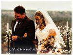"""personalized wood picture of bride and groom at wedding with the text, """"I loved her first"""""""