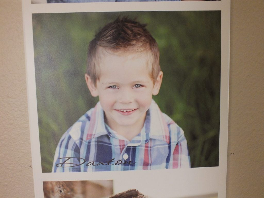 wood print photo of boy smiling with name lower left corner