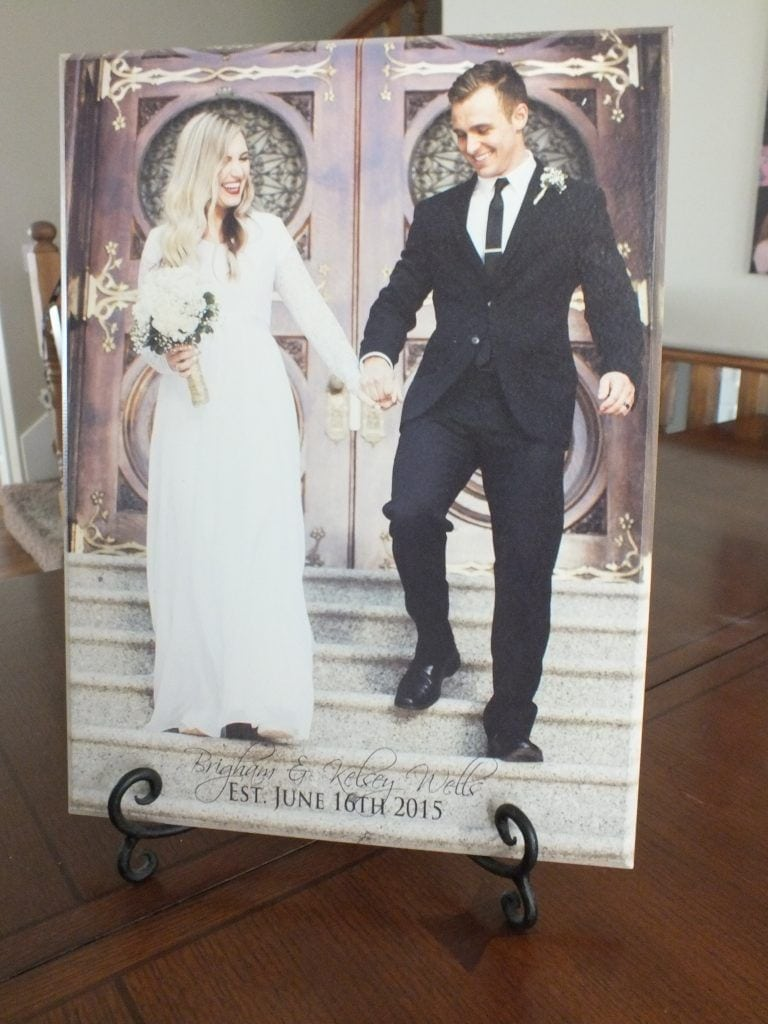 wood wedding photo of bride and groom on display on photo stand at home