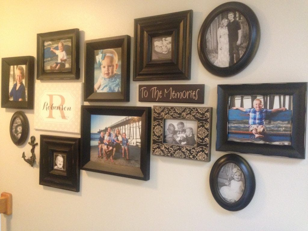 nine wood photos on wall at home