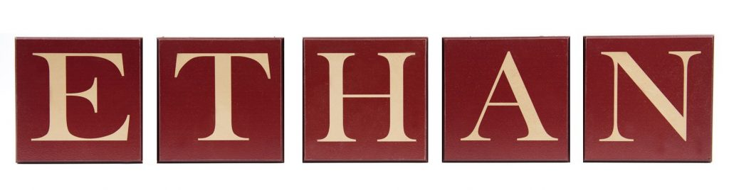 Boys personalized name letters. Red wood blocks with tan text.