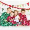 wood Christmas photo of children in their Christmas pajamas