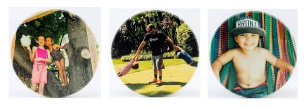 three round photo prints on wood from Instagram with gray square background
