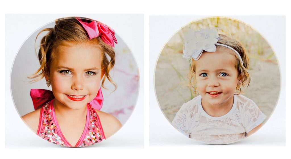 two round photos printed on wood with white square background. images of two daughters